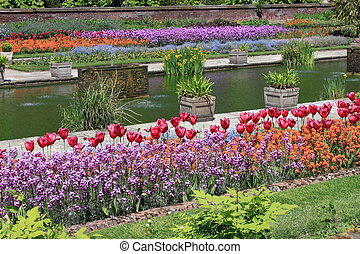 Beautiful formal garden - Flowerbeds and stone pathway in a...