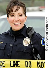Smiling officer - a Hispanic female police officer smiling...