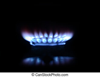 blue flame of gas on a black background