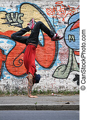 Vertical Breakdance - A performing HipHop Dancer in front of...