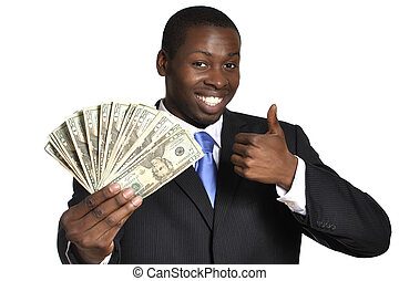 Success - Young successful businessman flaunts handful of...