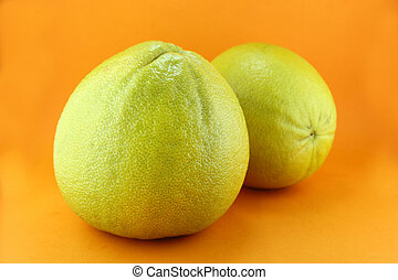 Bergamot oranges on orange background