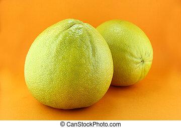 Bergamot oranges on orange background