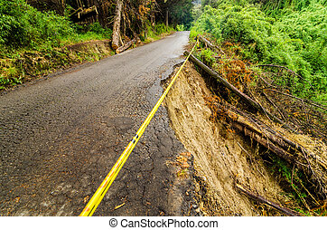Collapsed Road - A rural road that has been washed out and...