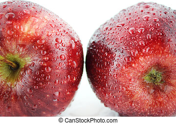 Fresh red apple with water drops on white background