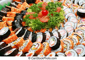 japanese maki - a variety of japanese maki served in a tray...