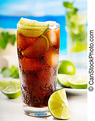 cocktail with lime and Cola on beach