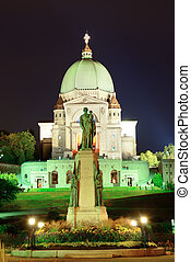 St. Joseph's Oratory with statue at night in Montreal in...