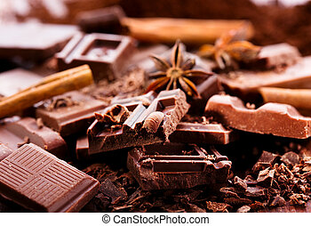 Chocolate pieces - pieces of chocolate on wooden table