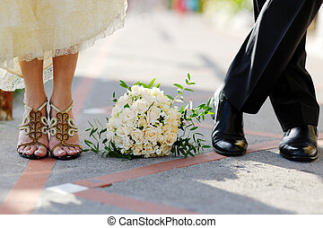 Groom and  bride with bouquet