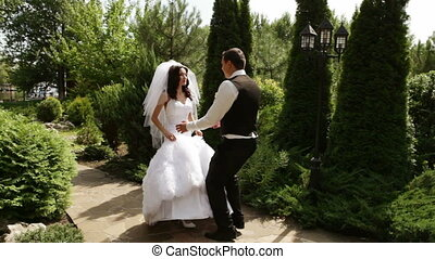 Groom and fiancee hurry on meeting - A groom and fiancee...