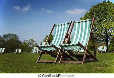 Deckchairs in London Park - Deckchairs in Park, London with...