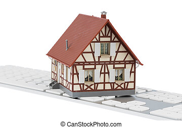 house on keyboard symbol photo for house purchase and rental...