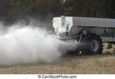 Spreading white fertiliser - Spreading a cloud of white...
