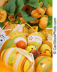 Easter decorations on green background