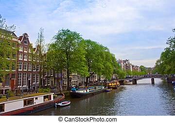 canal ring of Amsterdam, Netherlands - old houses on canal...