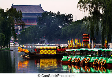 Houhai Lake Tourboats Drum Tower In Background Beijing, China