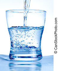 Glass of water - Water flowing in a glass