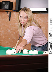 Girl at billiards table - Girl in casual wear playing...