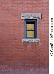 brick wall with a small window - red brick wall and small...