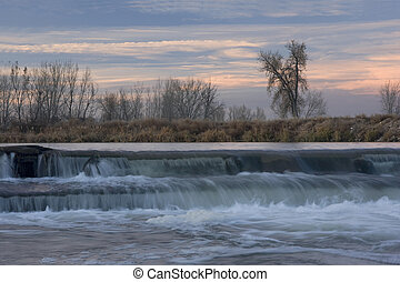 small river diversion dam in north eastern Colorado - dam on...