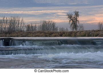 small river diversion dam in north eastern Colorado - dam on...
