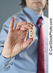 Businessman holding gambling dices