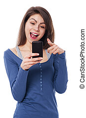 Excitement woman with mobile phone pointing at camera