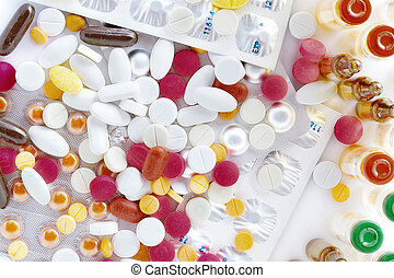 pills - Close up view of different pills on white back