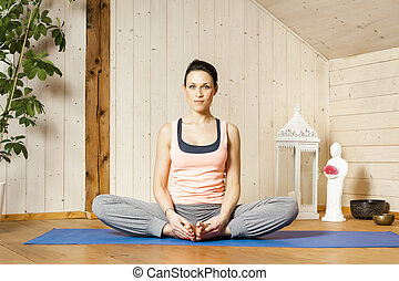 yoga woman - An image of a pretty woman doing yoga at home -...