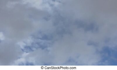 Moving clouds with rain - Blue sky with moving clouds with...