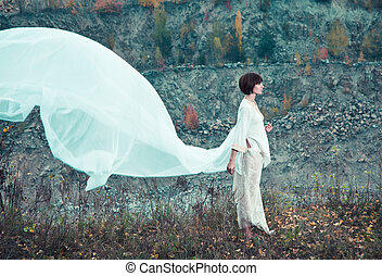 Woman in white flying fabrics