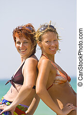 Beach babes - Young women at beach, smiling, portrait