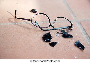 Broken Sunglasses - Broken sunglasses on clay floor.