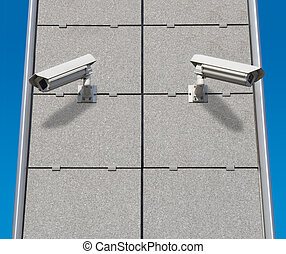 Security Cameras - Two Security Cameras Monitoring at...