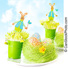 Easter eggs with bunny toys - Vivid colorful eggs in green...