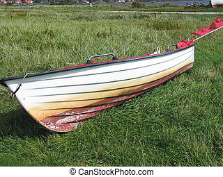 Small Skiff boat on the seashore - Small fishing Skiff boat...