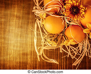 Beautiful Easter still life, chicken eggs in dry nest on...