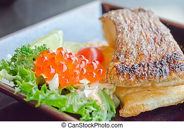 Japanese dish - grilled cod fish served with fresh salad...