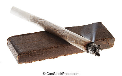 Lit Joint and 20 Grams of Hashish - Alit joint laid on a 20...