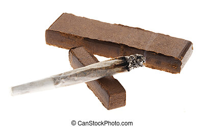 Lit Joint & Two Pieces of Hashish - A lit joint laid on two...