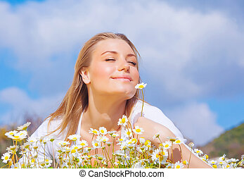 Beautiful woman enjoying daisy field and blue sky - Happy...