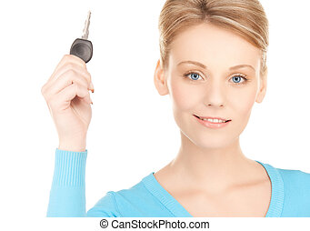 happy woman with car key - bright picture of smiling woman...