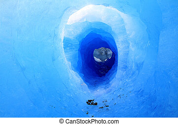 A tunnel in a glacier. Shot in Patagonia, South America.