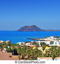 a view of Lobos Island from Corralejo in Fuerteventura,...
