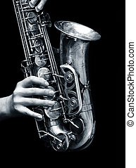 saxophone player - Saxophone player on black background...