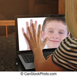 Family on Web Cam Laptop Together - A mother is touching the...