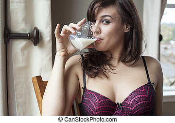 Beautiful Young Woman Drinking Glass of Milk - Beautiful...