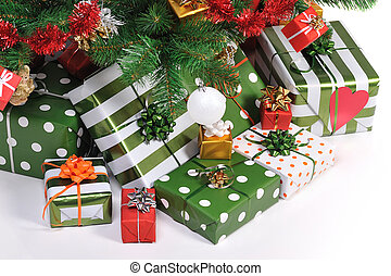 Christmas gifts under decorated Christmas fir tree