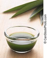 pandan juice - close up of a bowl of pandan juice